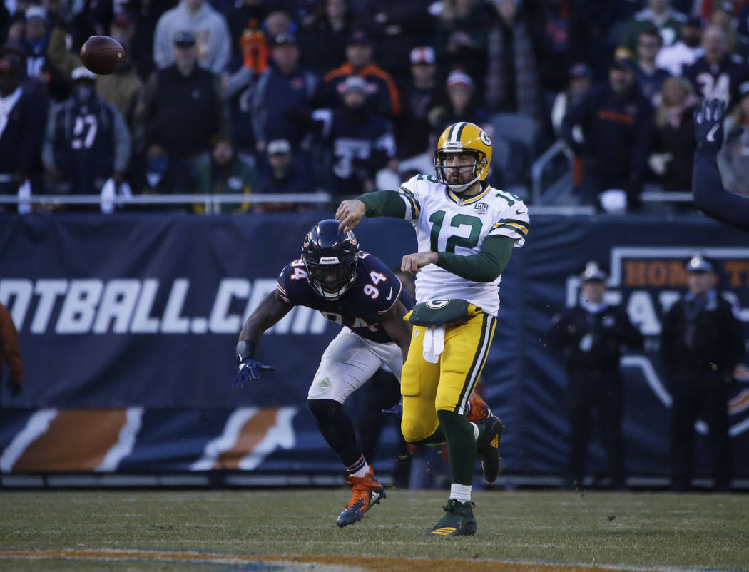 Green Bay Packers quarterback Aaron Rodgers (12) looks to pass against the Chicago Bears during ...