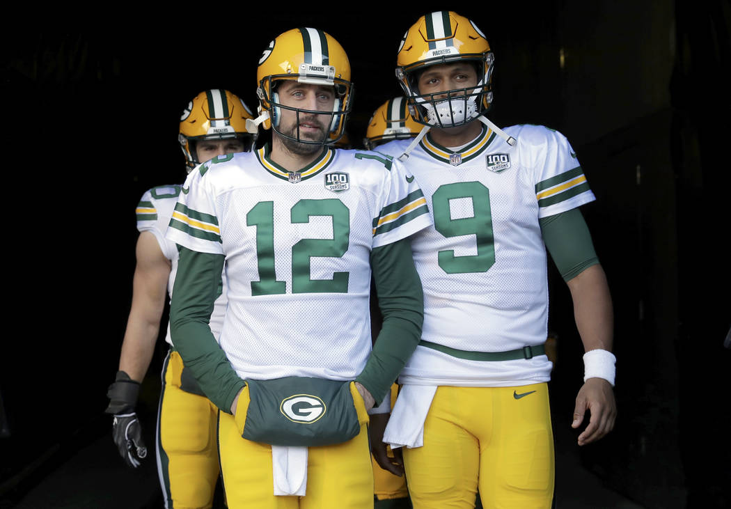 FILE - In this Sunday, Dec. 16, 2018, file photo, Green Bay Packers quarterbacks Aaron Rodgers ...