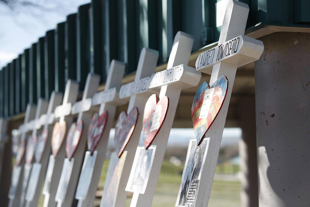 Crosses with the names of the victims of the massacre at Columbine High School nearly 20 years ...