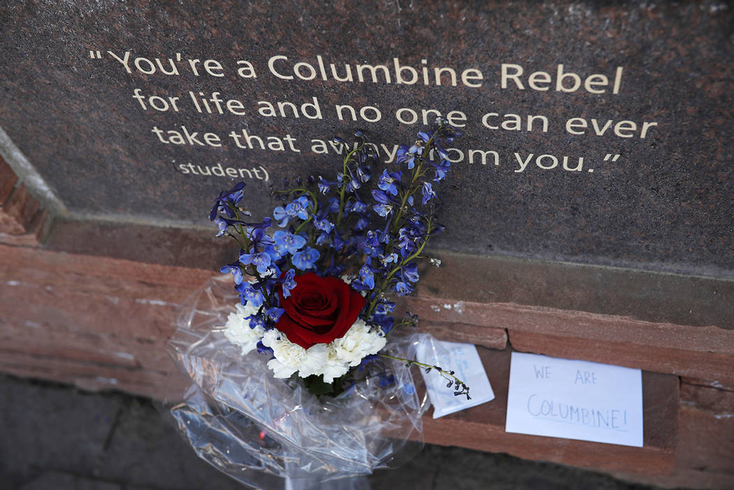 A bouquet of flowers stands in front of one of the plaques in the memorial for the victims of t ...