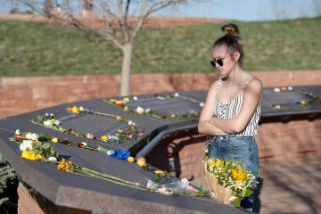 Sixteen-year-old Maren Strother of Denver looks over the plaques for the victims of the Columbi ...