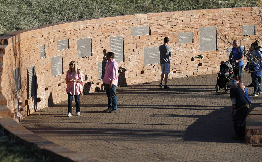 People visit the Columbine Memorial before a vigil at the site for the victims of the massacre ...
