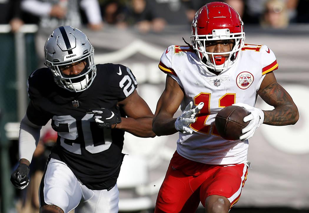 Kansas City Chiefs wide receiver Demarcus Robinson (11) runs in front of Oakland Raiders corner ...