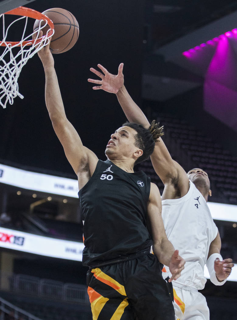 Cole Anthony (50) slices to the rim past Cassius Stanley (4) in the first half during the Jorda ...