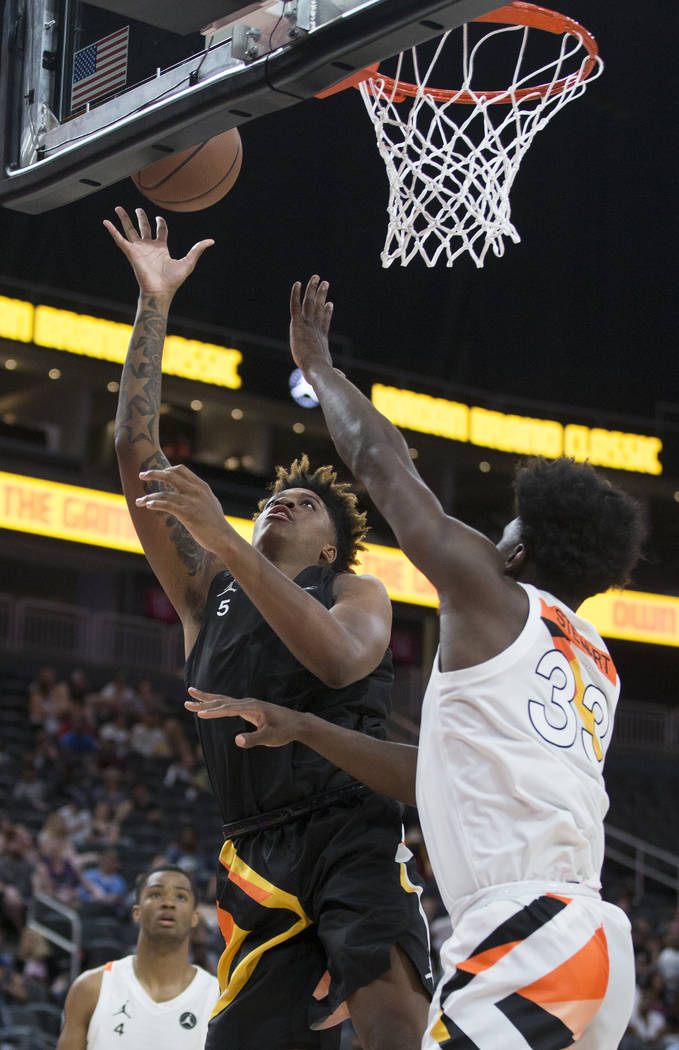 Armando Bacot Jr. shoots over Isaiah Stewart (33) in the first half during the Jordan Brand Cla ...