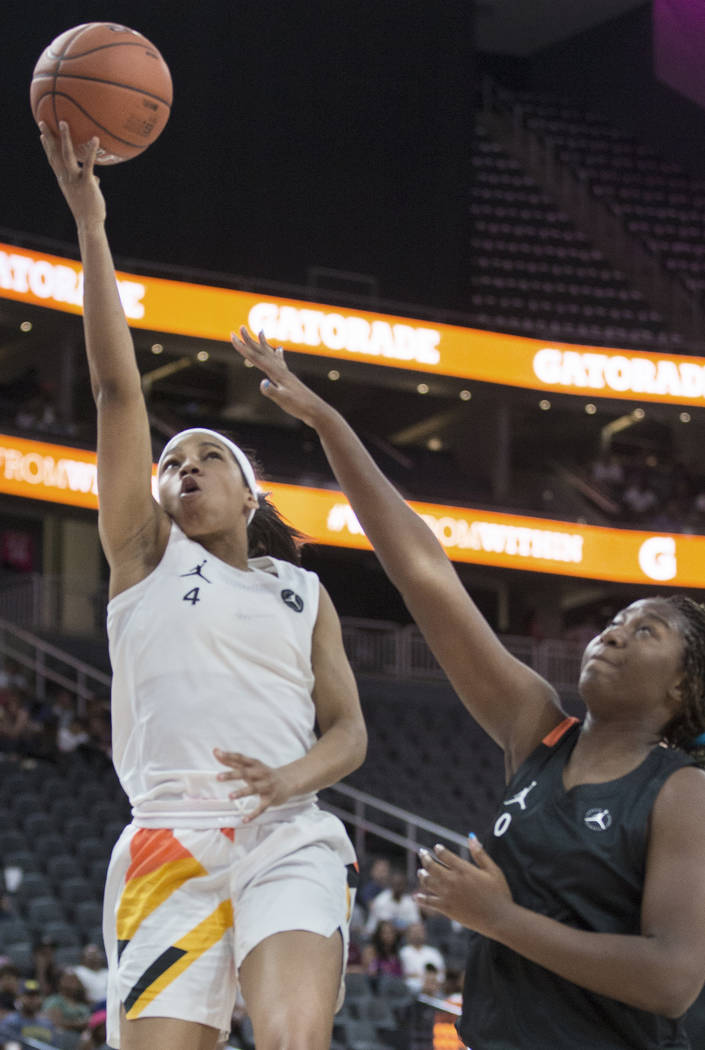 Zia Cooke (4) slices to the rim past Aliyah Boston (0) in the third quarter during the Jordan B ...