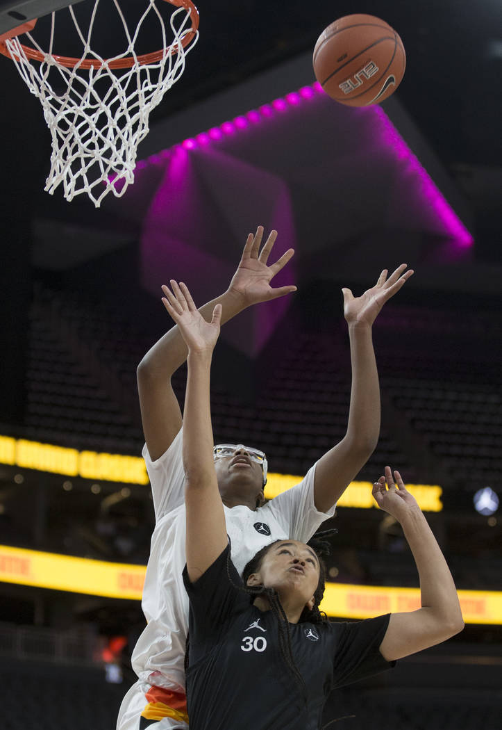 Francesca Belibi (1) attempts a dunk over Haley Jones (30) in the fourth quarter during the Jor ...