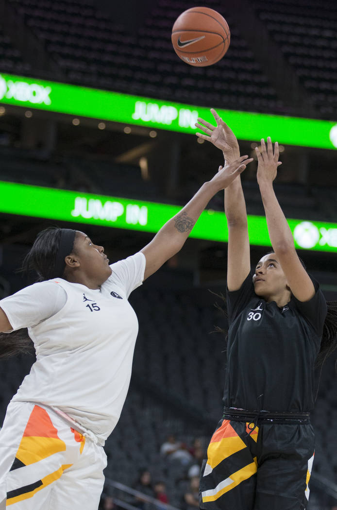 Haley Jones (30) shoots over Angel Jackson (15) in the second quarter during the Jordan Brand C ...