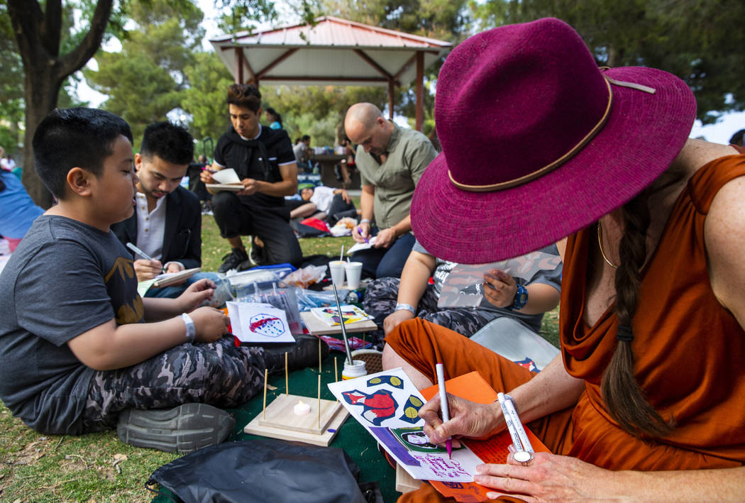 Charlotte Fox and friends decorate their lanterns during the Water Lantern Festival at Sunset P ...