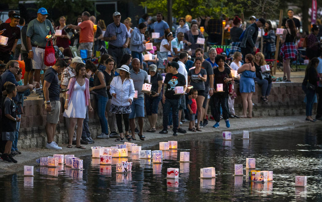 The first wave of lantern makes it to the water during the Water Lantern Festival at Sunset Par ...