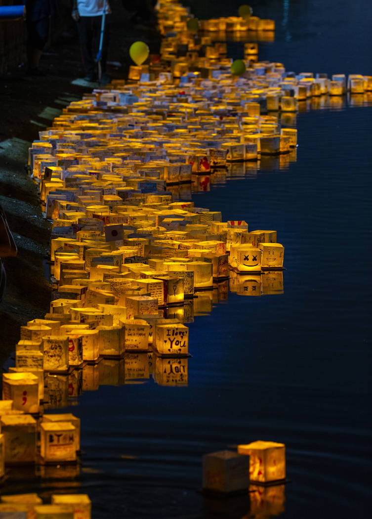 Lanterns gather near the shore during the Water Lantern Festival at Sunset Park on Saturday, Ap ...