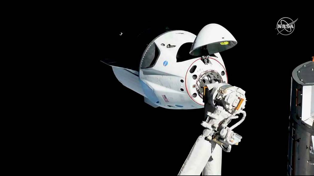 In this Sunday, March 3, 2019 file photo provided by NASA, the SpaceX Crew Dragon is pictured a ...