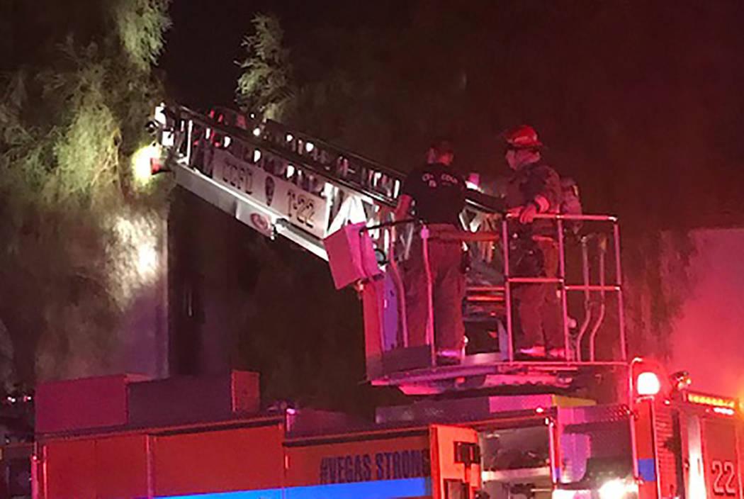 Firefighters battle a blaze at 3231 Jericho St. in Las Vegas on Saturday, April 20, 2019. (Clar ...