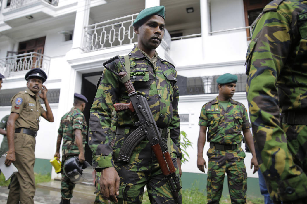 Sri Lankan security forces officers secure a site believed to be a hide out of the militants fo ...