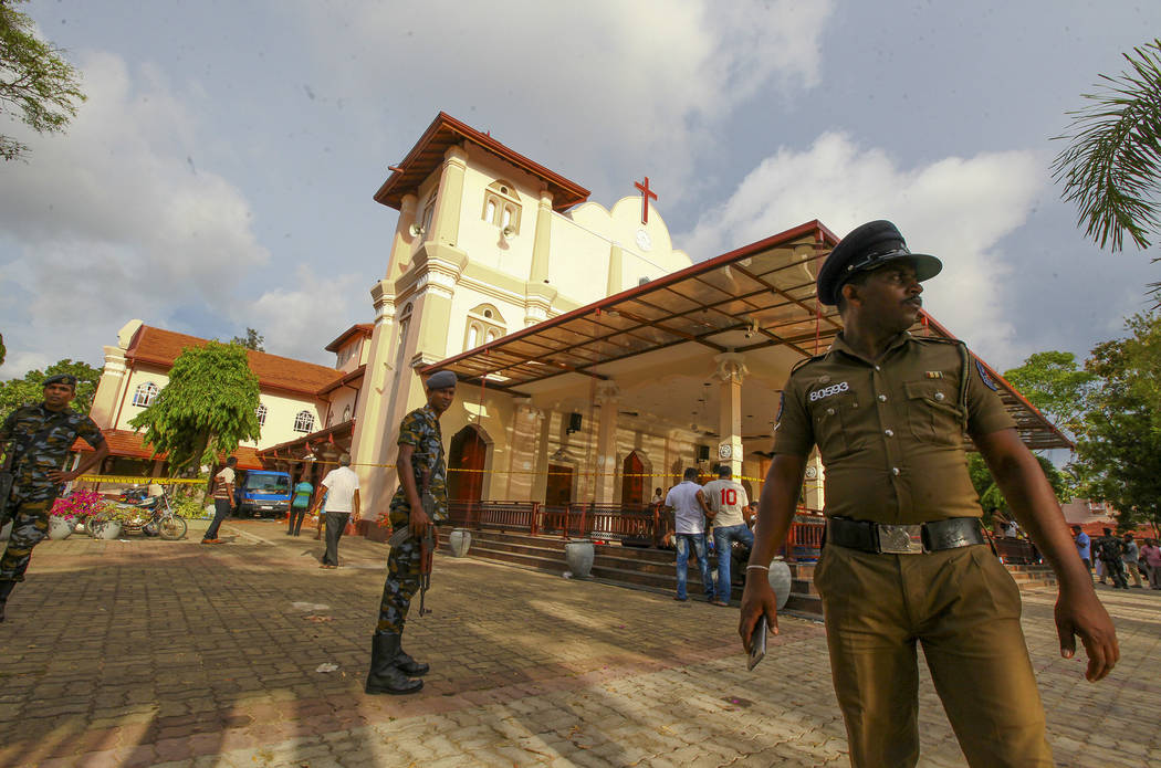 Sri Lankan army soldiers secure the area around St. Sebastian's Church damaged in blast in Nego ...