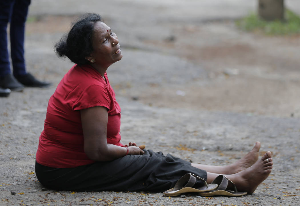 A relative of a blast victim grieves outside a morgue in Colombo, Sri Lanka, Sunday, April 21, ...