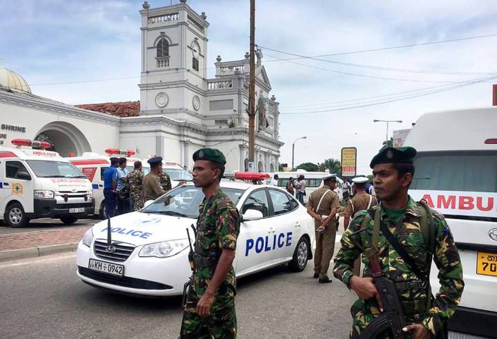 Sri Lankan Army soldiers secure the area around a church after a blast in Colombo, Sri Lanka, S ...