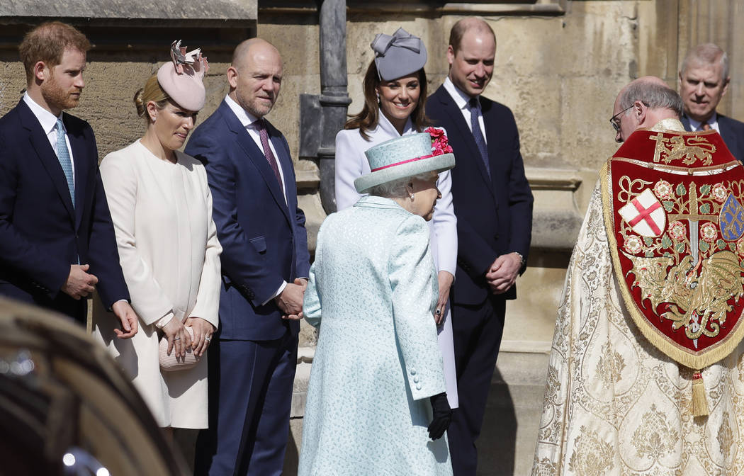 Members of Britain's Royal family watch as Britain's Queen Elizabeth II arrives to attend the E ...