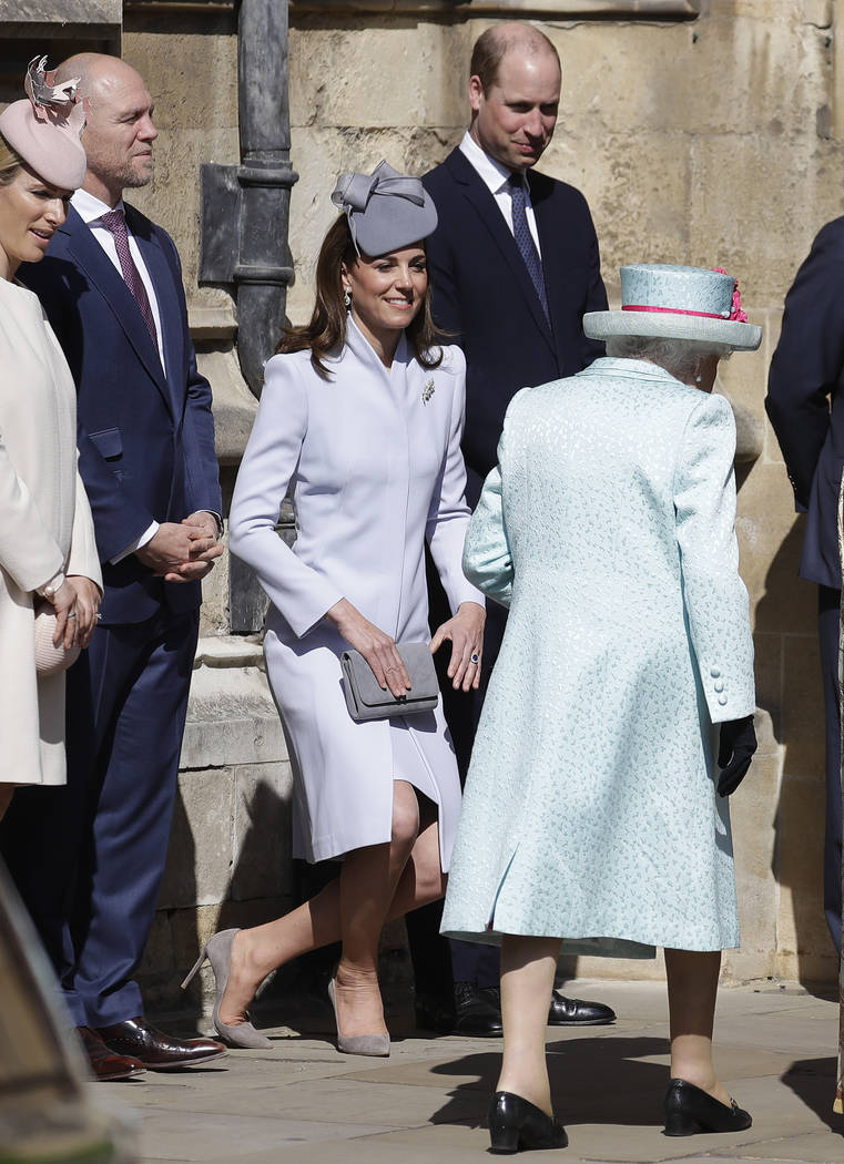 Britain's Kate, The Duchess of Cambridge curtsies as Britain's Queen Elizabeth II arrives to at ...