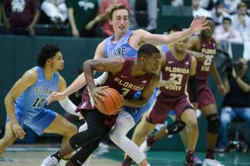 Florida State guard Trent Forrest (3) runs with the ball against Tulane guard Moses Wood during ...