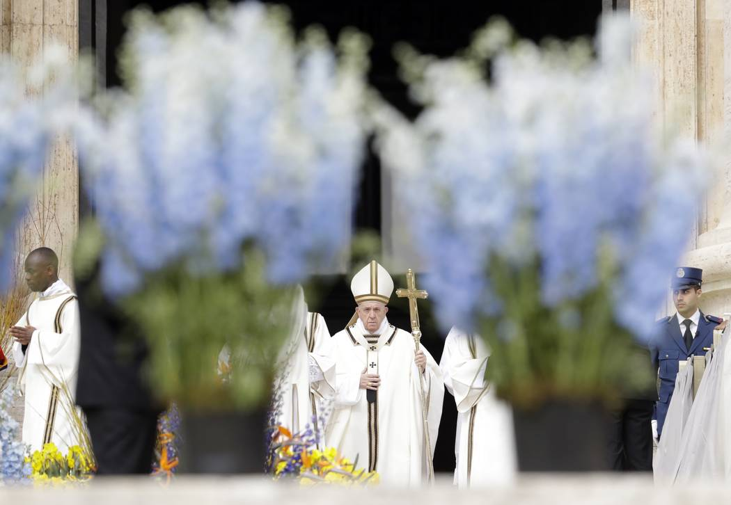 Pope Francis celebrates Easter Mass in St. Peter's Square at the Vatican, Sunday, April 21, 201 ...