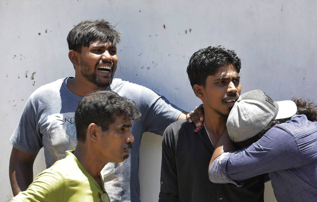 Relatives of a blast victim weep outside a police morgue in Colombo, Sri Lanka, Sunday, April 2 ...