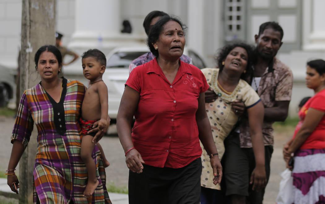 Relatives of a blast victim grieve outside a morgue in Colombo, Sri Lanka, Sunday, April 21, 20 ...