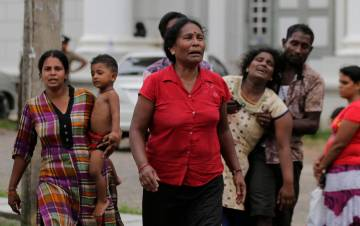 Relatives of a blast victim grieve outside a morgue in Colombo, Sri Lanka, Sunday, April 21, 20 ...