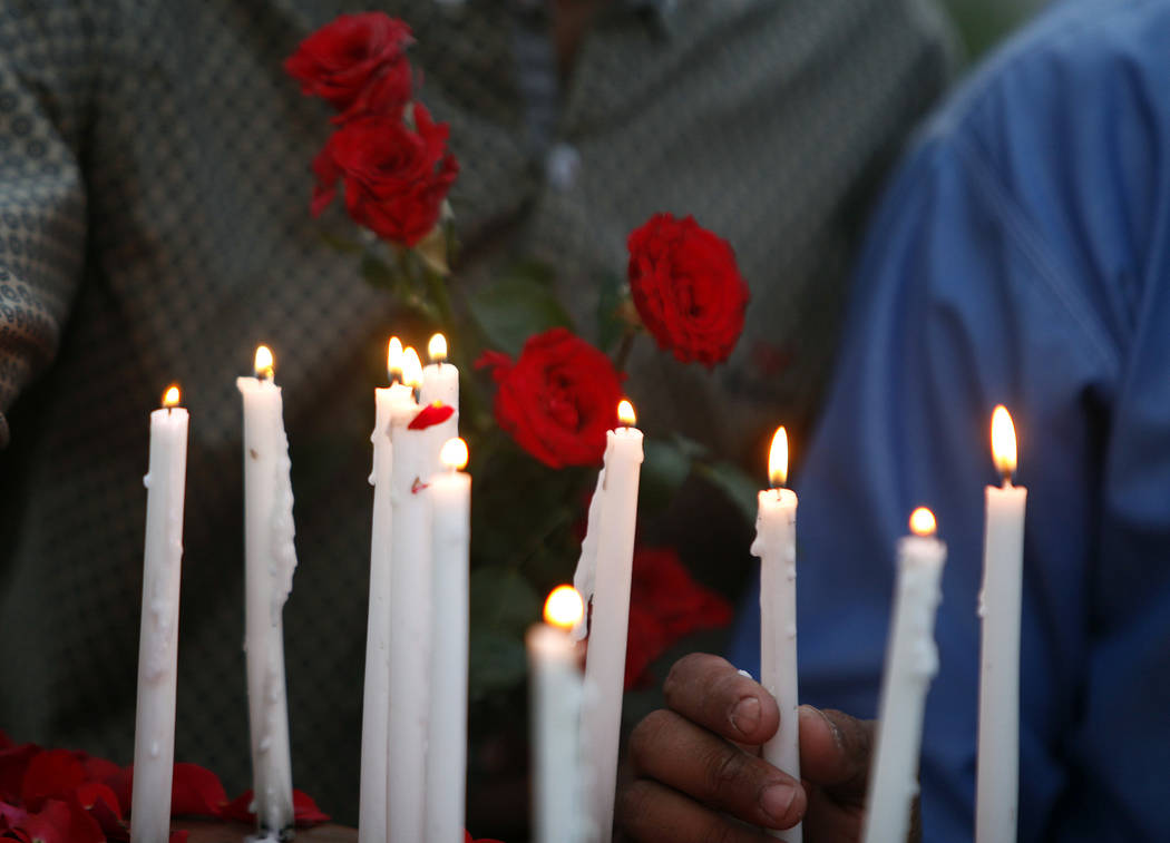 Pakistani Christians hold a candle light vigil for the for the victims of bomb explosions in ch ...