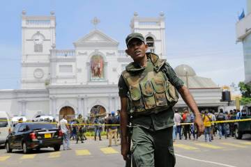 Sri Lankan Army soldiers secure the area around St. Anthony's Shrine after a blast in Colombo, ...