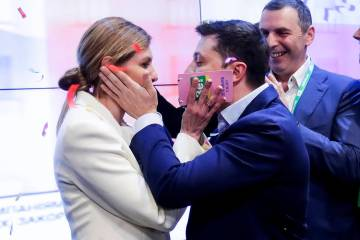 Ukrainian comedian and presidential candidate Volodymyr Zelenskiy, and his wife Olena Zelenska ...