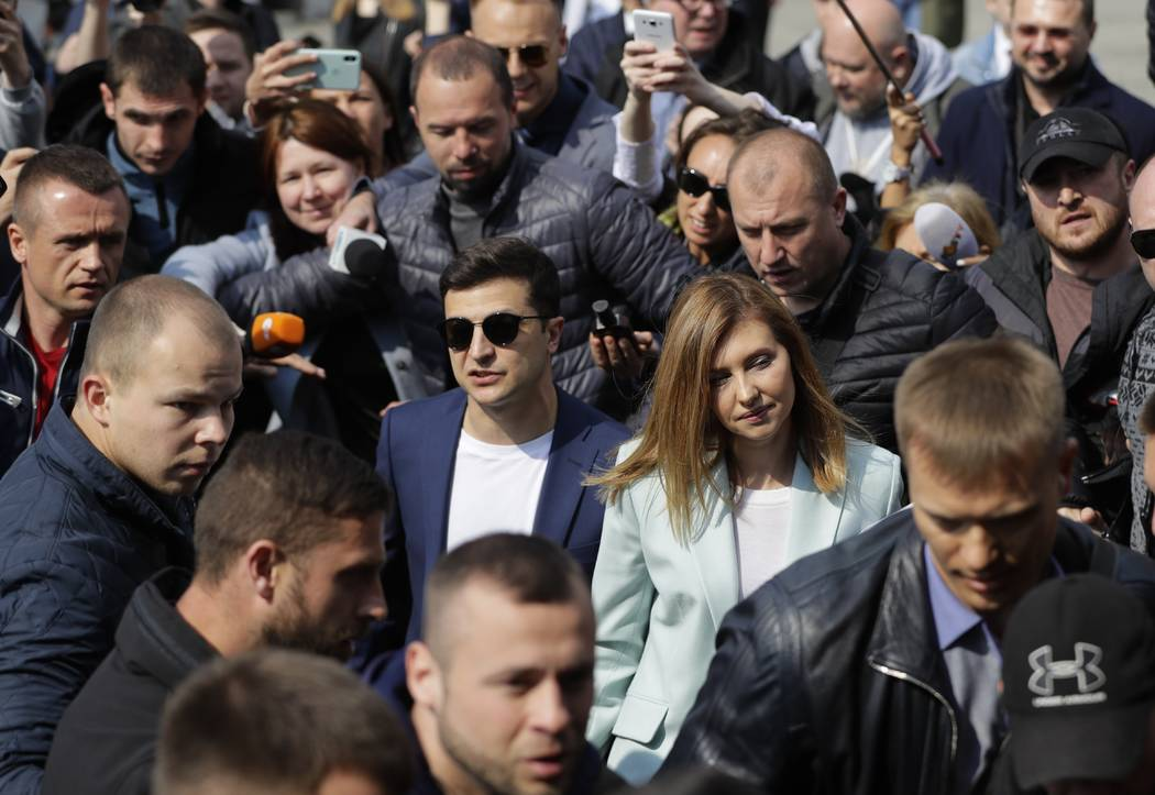 Ukrainian comedian and presidential candidate Volodymyr Zelenskiy, center left, and his Olena Z ...
