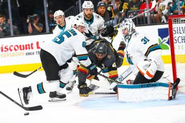 San Jose Sharks goaltender Martin Jones (31) and defenseman Erik Karlsson (65) block a shot fro ...