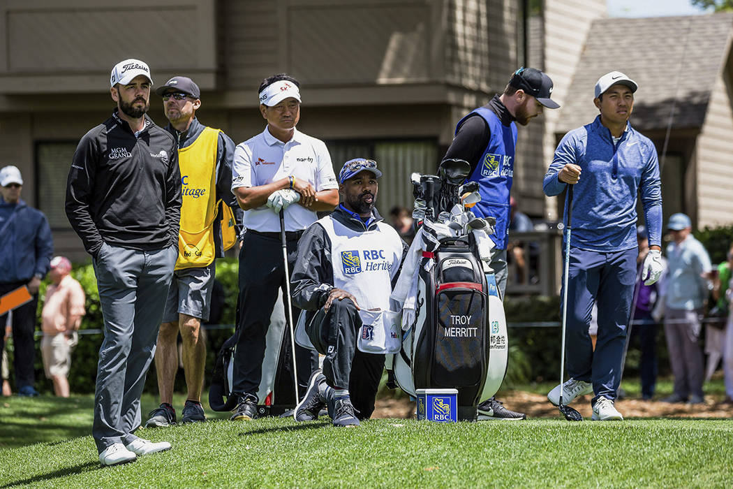 Troy Merritt, far left, K.J. Choi, third left, and C.T. Pan, far right, wait to tee off on the ...