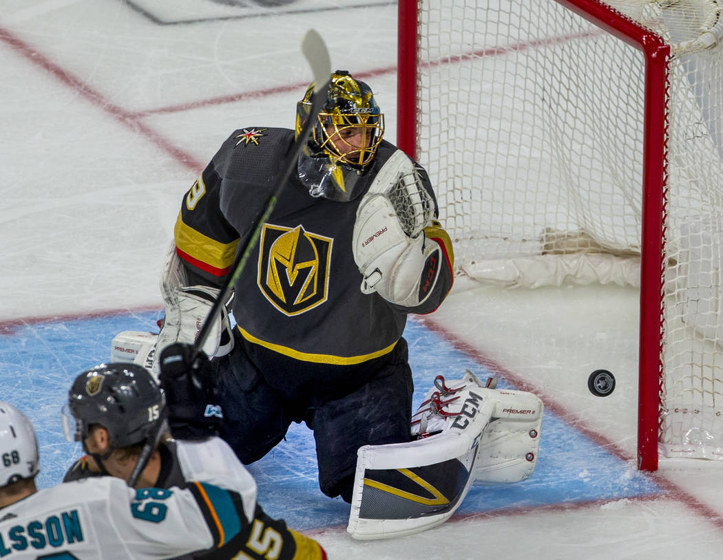 Golden Knights goaltender Marc-Andre Fleury (29) looks as a puck bounces off the post during th ...