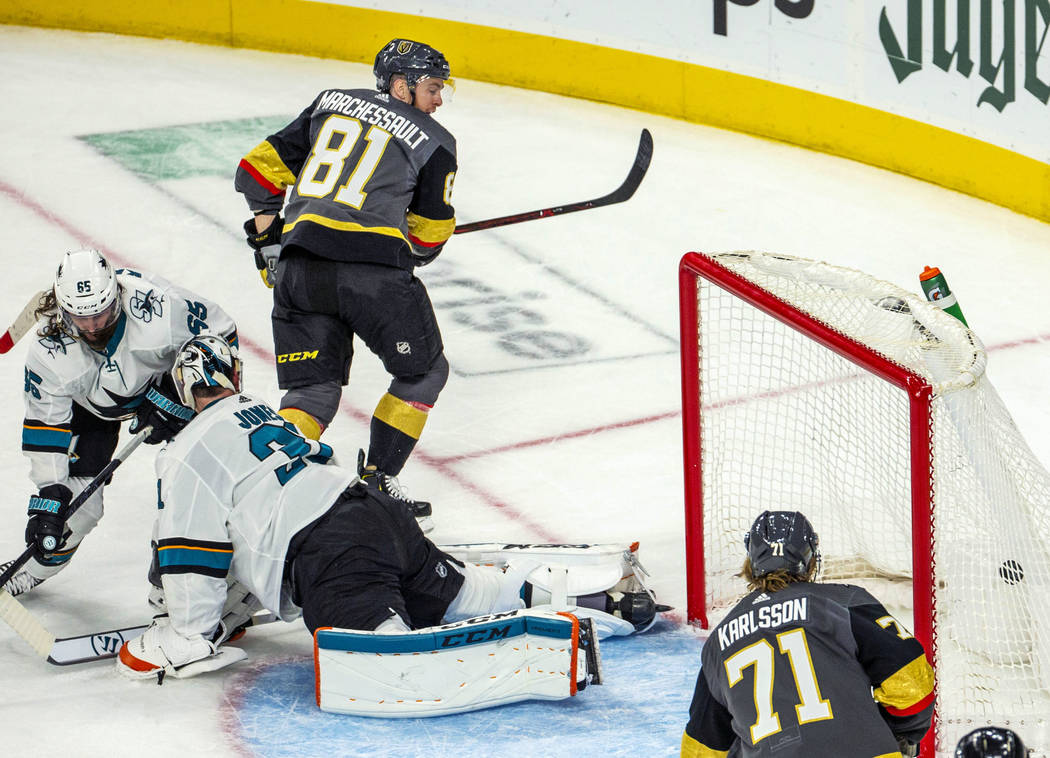 Golden Knights center Jonathan Marchessault (81) scores over San Jose Sharks goaltender Martin ...