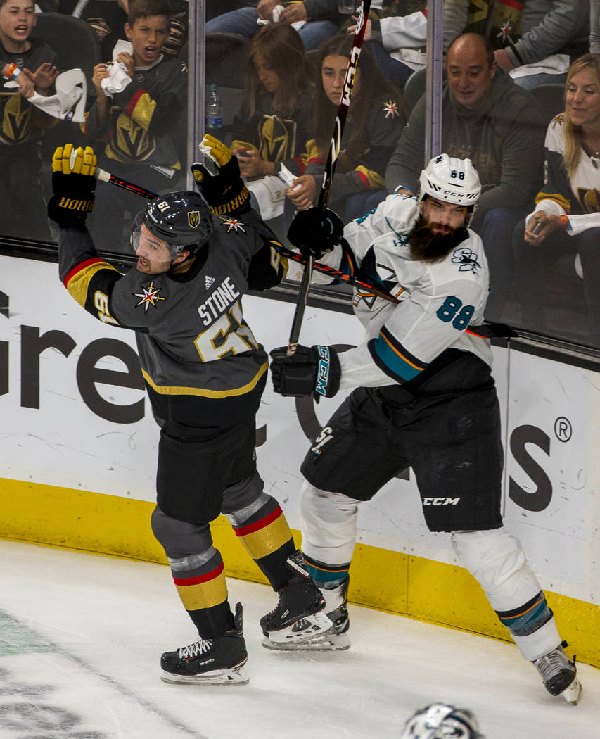 Golden Knights right wing Mark Stone (61) tangles with San Jose Sharks defenseman Brent Burns ( ...