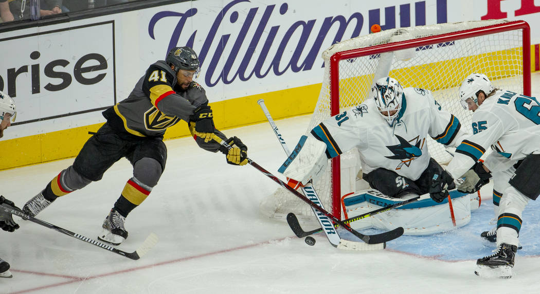 Golden Knights center Pierre-Edouard Bellemare (41) looks to sneak in a goal over San Jose Shar ...