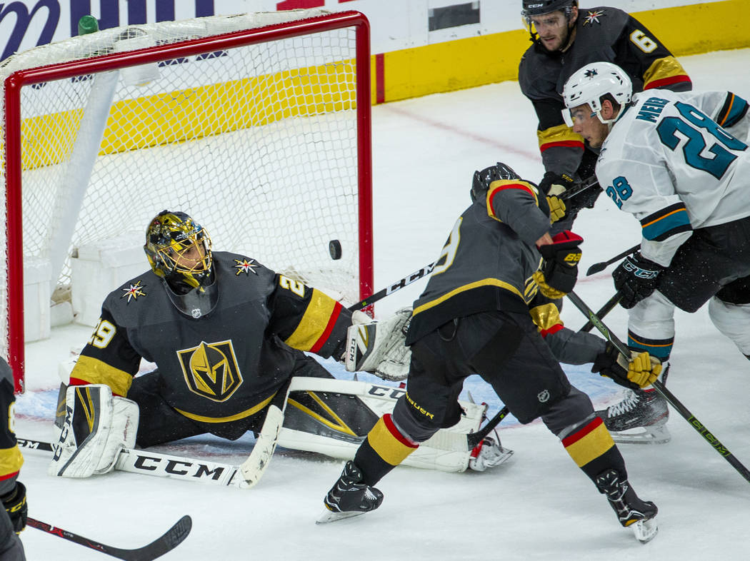 Golden Knights goaltender Marc-Andre Fleury (29) looks to a loose puck deflected by San Jose Sh ...
