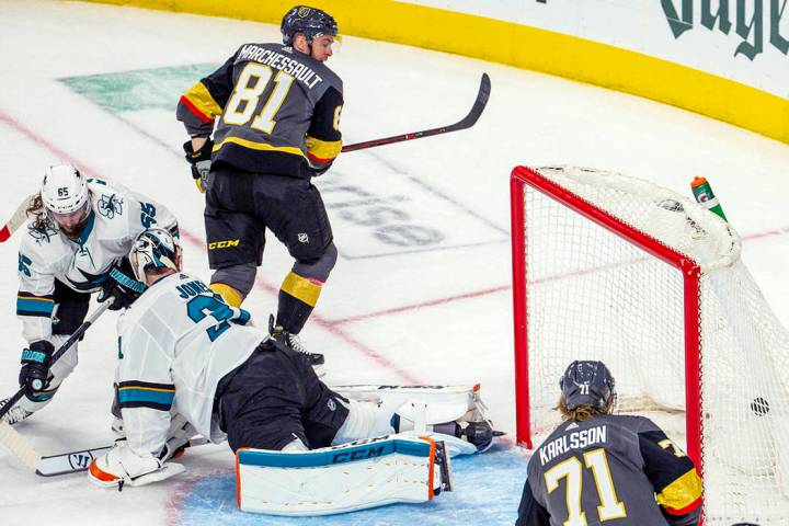 Golden Knights center Jonathan Marchessault (81) scores over San Jose Sharks goaltender Martin ...