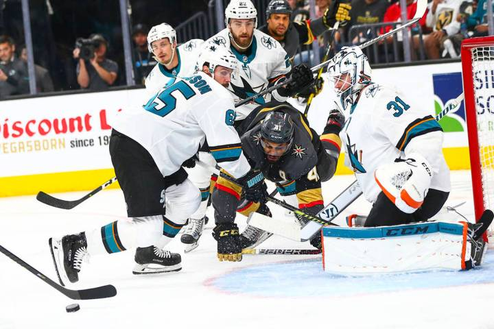 San Jose Sharks goaltender Martin Jones (31) and defenseman Erik Karlsson (65) block a shot fro ...