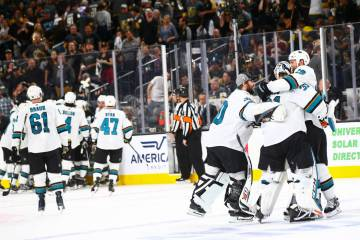San Jose Sharks center Joe Thornton (19) and backup goaltender Aaron Dell (30) embrace goaltend ...