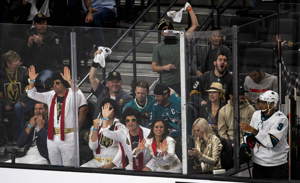 The Elvis themed Golden Knights fans help celebrate a goal by Golden Knights center Jonathan Ma ...
