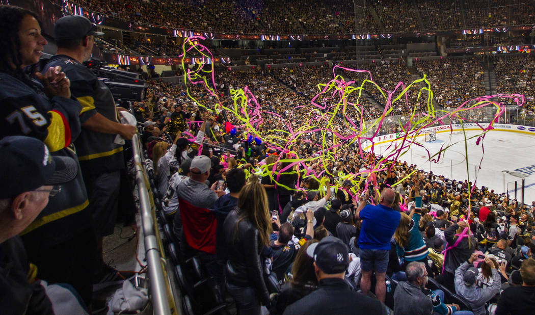 Fans are covered with streamers during the second overtime period of Game 6 of an NHL Western C ...