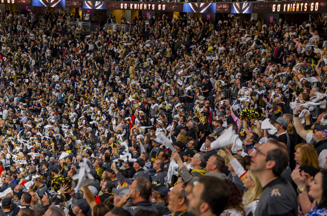 "Golden Knights fans wave their ""battle towels"" during the second overtime period of G ..."