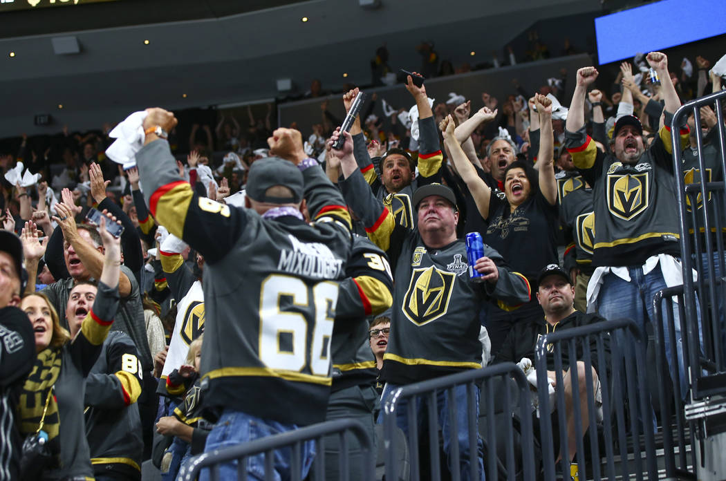 Golden Knights fans celebrate a goal by Golden Knights center Jonathan Marchessault, not pictur ...