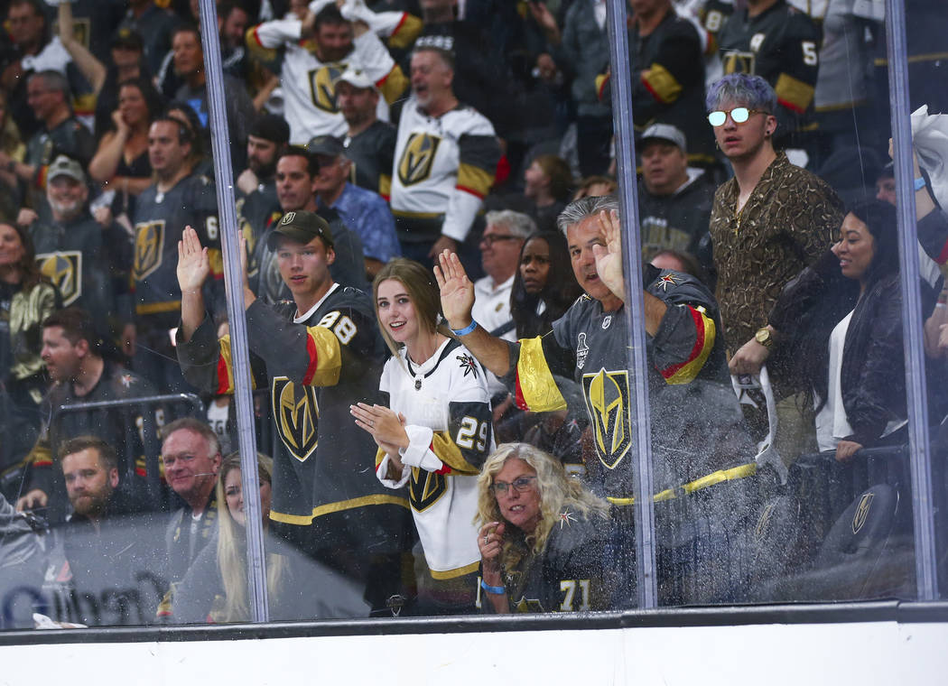 Golden Knights fans cheer during the first overtime period of Game 6 of an NHL Western Conferen ...