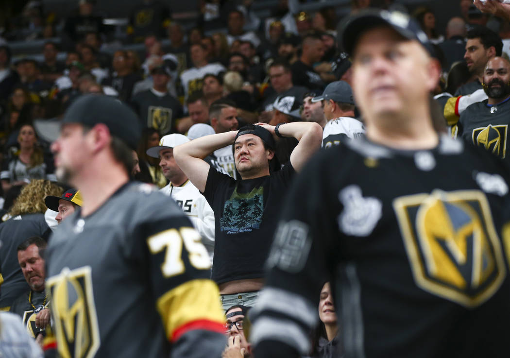 Golden Knights fans react after losing to the San Jose Sharks in a double overtime period in Ga ...