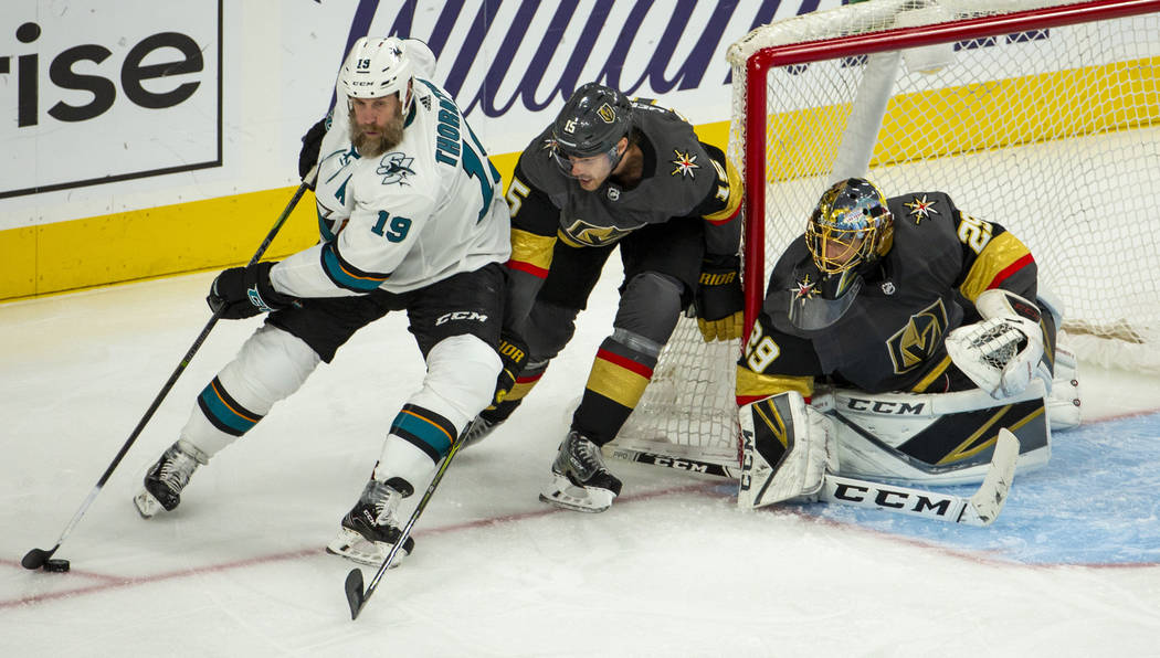 /s19 attempts to turn the corner for a shot over Golden Knights defenseman Jon Merrill (15) an ...