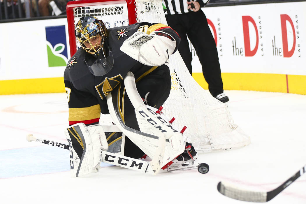 Golden Knights goaltender Marc-Andre Fleury (29) blocks a shot from the San Jose Sharks during ...